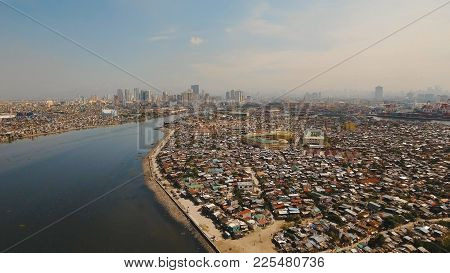 Aerial View Poor District Of Manila Slums, Ghettos, Wooden Old Houses, Shacks. Slum Area Of Manila,