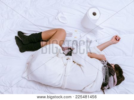 The Girl In A White Coat Is Very Ill, Lies In Bed All Day, Sore Throat And Head