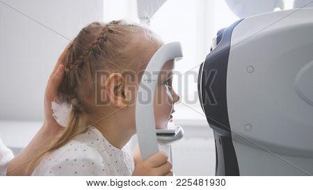 Children Ophthalmology - Optometrist Checks Child's Eye