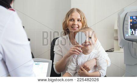Optometrist In Clinic Checking Little Child's Vision - Medicine