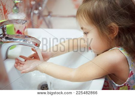 Kid With Fair Hair, Wearing T-shirt And Thoroughly Washing Hands In Bathroom With Water And Soap, Fo