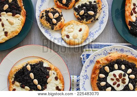 Yeast Cake With Almond, Raisin And Cheese On Plate