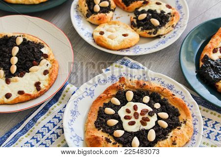 Yeast Cake With Almond, Raisin, Poppy And Cheese On Plate
