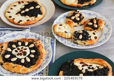 Yeast Cake With Almond, Raisin, Poppy And Cheese On Plate And Dish Towel