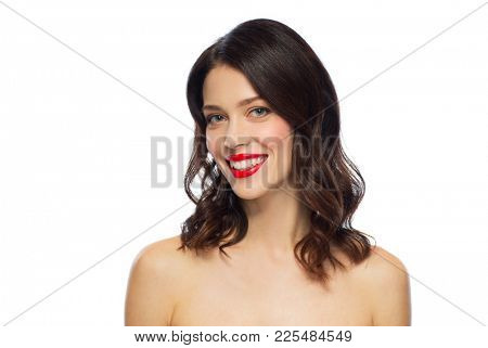 beauty, make up and people concept - happy smiling young woman with red lipstick over white background