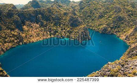 Aerial View: Mountain Barracuda Lake, On Tropical Island With Blue Water. Lake In The Mountains Cove