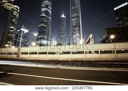 Empty Road Surface With City Landmark Buildings Of Night