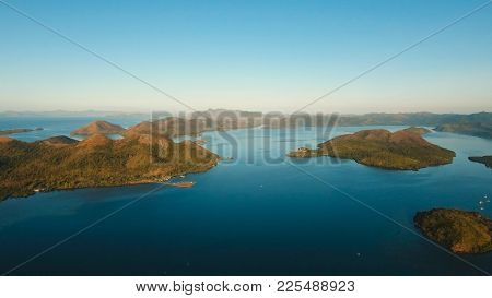 Aerial View: Beach, Tropical Island, Sea Bay And Lagoon, Mountains With Rainforest, Busuanga, Palawa