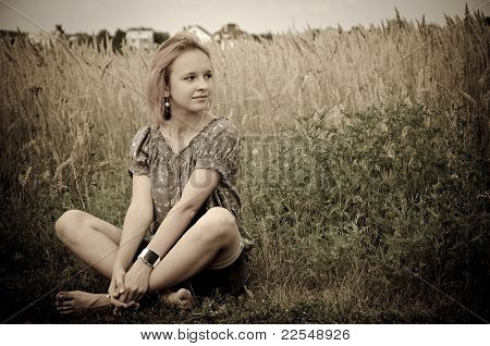 Girl In The Field On A Farm