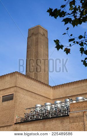 Brick chimney and walls of the Bankside Power Station, a former electricity generating station now Tate Modern museum located  in the Bankside area of the Borough of Southwark London UK