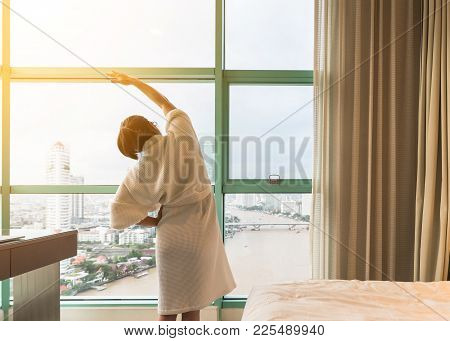 Hotel Guest Woman Happily Resting Waking Up In The Morning In Bedroom Of Luxury High Quality City Bu