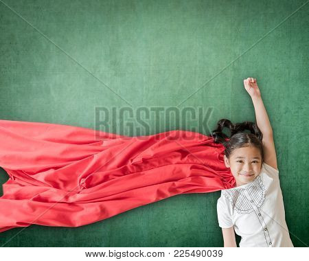 Superhero Asian School Girl Kid Student With Inspiration In Women Rights In Education Success Concep