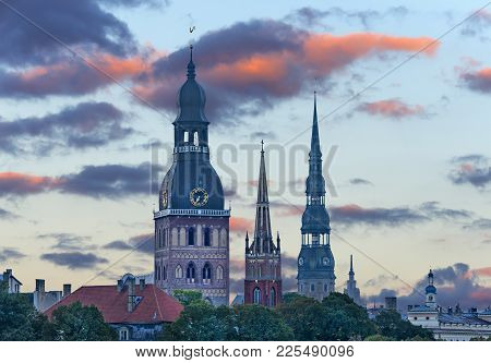 Medieval Churches In Historical Center Of Riga City. Riga Is The Capital Of Latvia And Famous Baltic