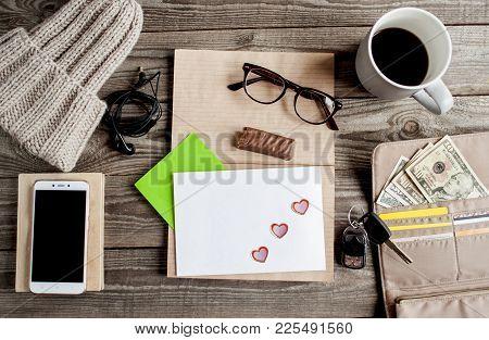 Freelance Work Space With Kraft Notebook, Private Envelope, Eyeglasses,  Cup Of Coffe, Bitten Chocol