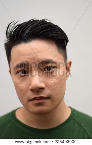 A Young Asian Male Chinese Looking At Camera