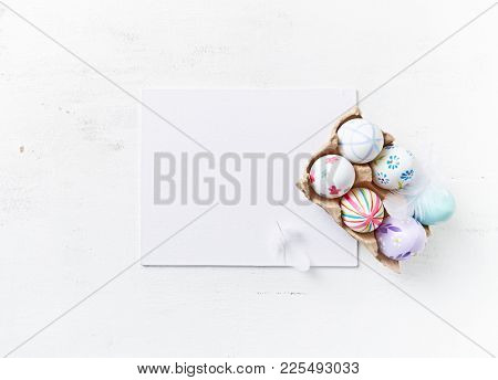 Easter Eggs in a Egg Box (flat lay arrangement)