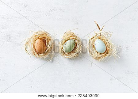 Speckled Easter Eggs in nests and in a row (flat lay arrangement)