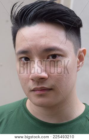 A Young Asian Male Chinese Staring At Camera