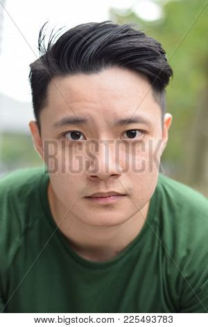 A Young Asian Male Asian Chinese Looking At Camera
