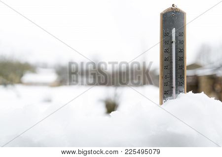 Thermometer On Snow Shows Low Temperatures Under Zero. Cold Winter Weather Under Zero.