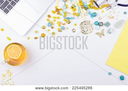 Handmade, Hobby, Craft Workspace Concept. Feminine Workplace In Flat Lay Style With Laptop, Yellow N