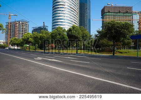 Empty Road Surface Floor With Buildings Background