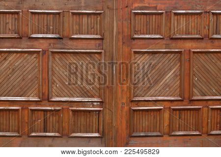 Wooden Garage Doors On An Upscale House