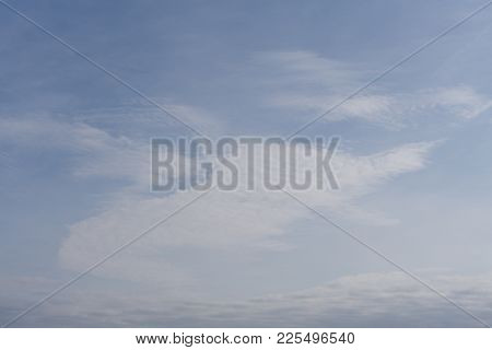 Light Blue Sky With Clouds - Abstract Background