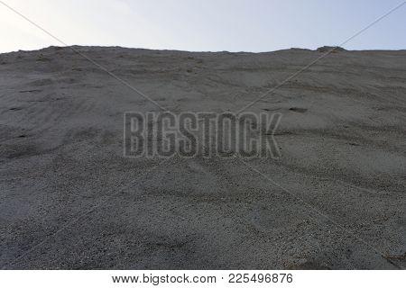 Sand Dunes In The Desert Nametennym Wind