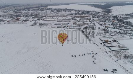 Hot Air Balloons In The Winter Season. Aerostat, Airship. Red Balloon.