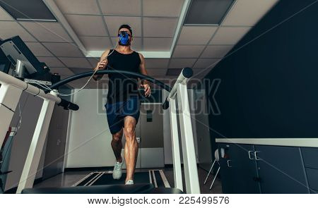 Athlete Analyzing His Performance In Sports Lab
