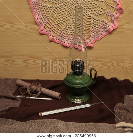 Kerosene Iron Lamp With Handle Thermometer And Rope On A Dark Background
