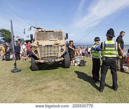Swansea, Uk: July 07, 2017: Two Police Officers Stand Near An Army Off-road Vehicle At Swansea Air S
