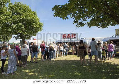 Swansea, Uk: July 07, 2017: People Wait In Line To Be Served A Drink At Swansea Air Show. The Annual