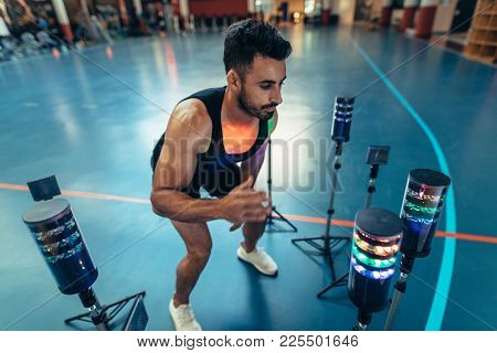 Athlete Using Visual Stimulus System At Sports Lab