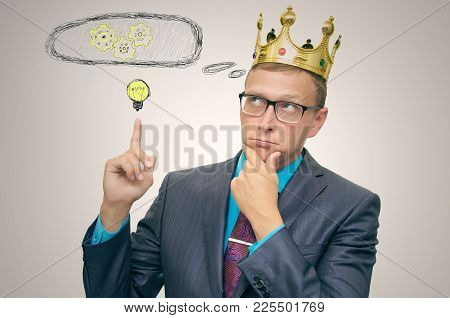 Birth Process Of New Idea. Pensive Business Man With Gold Crown Above His Head Is Thinking And Is Sh