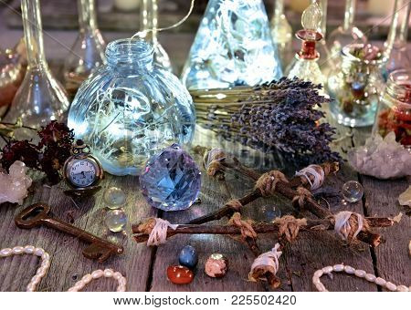 Magic Bottles With Lights, Pentagram, Crystal And Ritual Objects On Witch Table. Occult, Esoteric, D