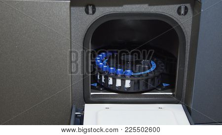 Medical Centrifuge For Mixing In The Laboratory. Tubes Prepared In Lab Centrifuge Machine . Modern T