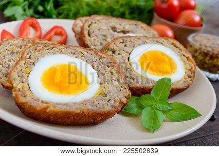 Meat Cutlet With Boiled Egg, Pieces On A Ceramic Plate On A Dark Wooden Background. Mini Meat Rolls.