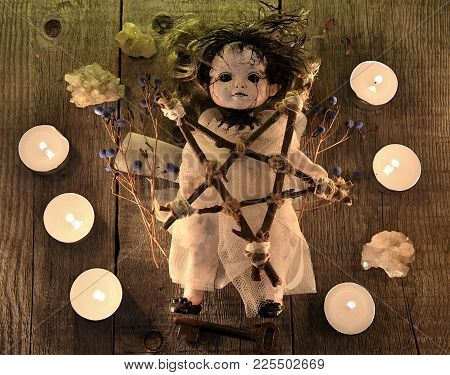 Scary Voodoo Doll With Candles, Pentagram And Poison Berries On Witch Table. Occult, Esoteric, Divin