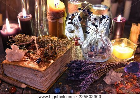 Witch Ritual Collection With Old Spelling Book, Lavender, Bottles, Herbs And Magic Objects. Occult,