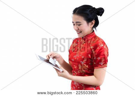 Portrait Of Asian Woman In Traditional Chinese Long Dress, Cheongsam, Black Hair, Using Tablet Scree