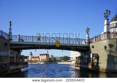 Kaliningrad, Russia - May 11, 2016: Cityscape With View Of The Historic Bridge And Walking People.