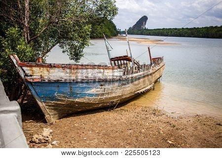Long Boat On The Bank Of The Krabi River. Thailand