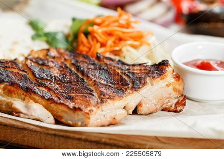 Pork Steak Grill. Serving On A Wooden Board On A Rustic Table. Barbecue Restaurant Menu, A Series Of