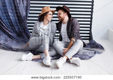 Portrait Of A Beautiful Young Happy Smiling Couple Looking To Each Other Modern Hipster Man And Woma