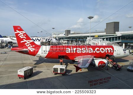 Changi Airport, Singapore: March, 2017: Airasia Berhad Is A Malaysian Low-cost Airline Headquartered