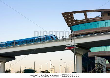Dubai, United Arab Emirates - February 5, 2018: Dubai Metro Train Running On The Elevated Viaduct In