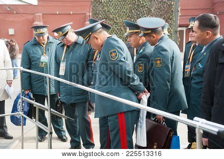 Nizhniy Tagil, Russia - September 25. 2013: Officers Of Kazakh Army Examine Armored Troop-carrier. R