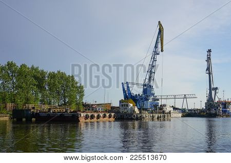 Kaliningrad, Russia - May 11, 2016: The Seaport At The River Pregol With Ships And Cargo Cranes On B